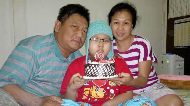 Meriel dan orang tuanya