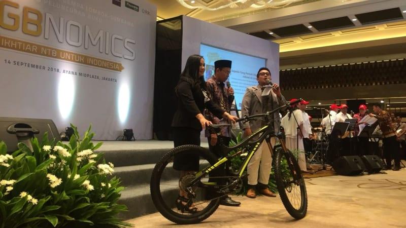 TGB, lelang sepeda, Jokowi, Gempa Lombok