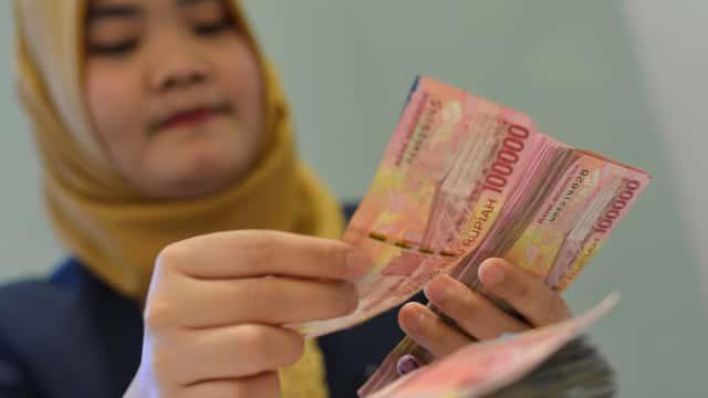 Pengusaha Desak Pemerintah Wajibkan Transaksi Dagang Pakai Rupiah